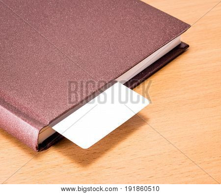 solid diary with a white bookmark on a wooden background business style a place for writing and advertising