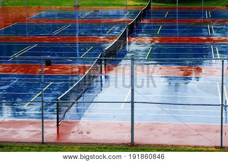 Detail of tennis courts in rain storm with water