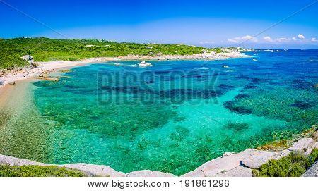 Lonely bay with azure water near Porto Pollo, Sardinia island, Italy.