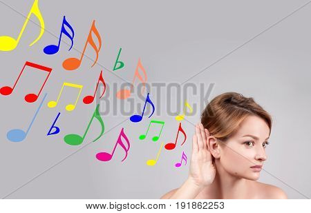 Woman Hold Hand Near Her Ear And Listening Music
