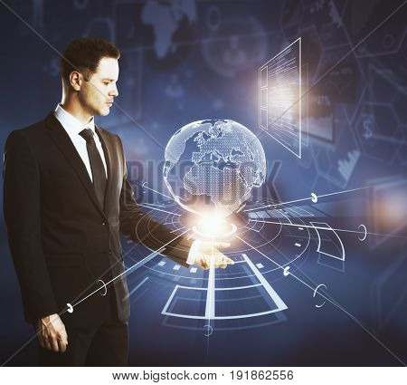 Side view of businessman holding abstract digital globe on dark background. Network concept. 3D Rendering