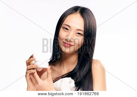 Facial, woman with cream on isolated background.