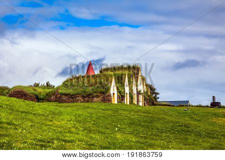 The picturesque village of old houses covered with turf and grass. The concept of the historical and cultural tourism