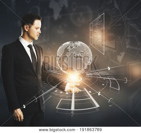 Side view of businessman holding abstract digital globe on dark background. International business concept. 3D Rendering