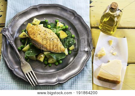 Chicken breast with parmesan and spinach salad