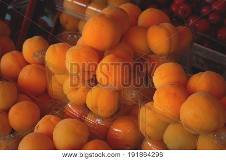 Fresh Apricots For Sale On Farmer's Market. Agriculture Background. Top View. Close-up
