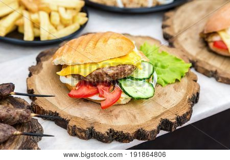 Hamburger with beef meat cheese and fresh vegetables on wooden board. Simple idea for vegetarian sandwich