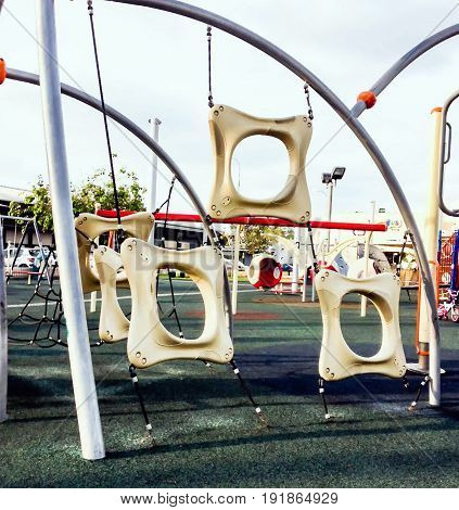 Children playground at small park in old port