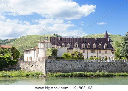 River bank Chateau in Ampuis, Auvergne-Rhône-Alpes, France