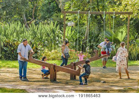 GUAYAQUIL, ECUADOR, MAY - 2016 - Families at children games at historic park located at samborondon neighborhood Guayaquil Ecuador