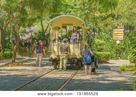 GUAYAQUIL, ECUADOR, MAY - 2016 -People at dld railcar model at the historic park a touristic attraction located in Guayaquil Ecuador.