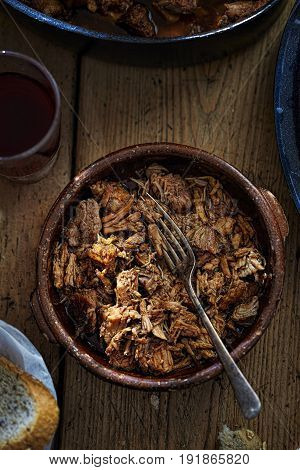 Slow cooked pulled pork in oven proof dish