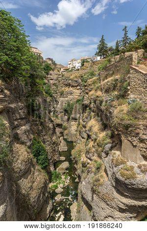 The El Tajo ravine on the south side of the New Bridge in Ronda Spain.