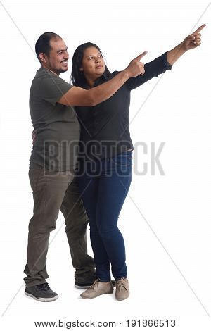 latinamerican couple pointing on a white background
