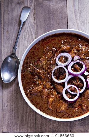 Mexican chicken mole with red onion and lime