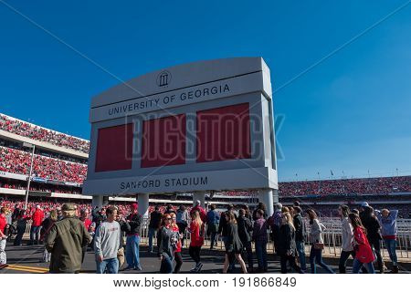 Athens Georgia United States: November 26 2017: Crowd passes under Sanford Stadium Sign on Game Day