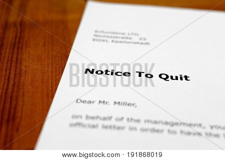 A letter on a wooden table - notice to quit