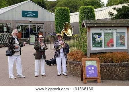 Wisley, Surrey, Uk - April 30 2017: Trad Jazz Trio Playing At The Entrance To The Rhs Wisley Garden