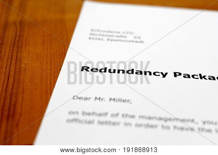 A letter on a wooden table - redundancy package
