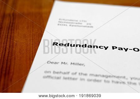A letter on a wooden table - redundancy payment