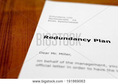 A letter on a wooden table - redundancy plan