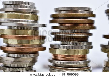 Close up of money - coins stacked on notes