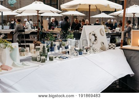 Copenhagen Denmark - August 11 2016. People in antiques and artisans street market in Frue Square in Copenhagen. Frue Plads is a public square located on the north side of the Church of Our Lady in central Copenhagen