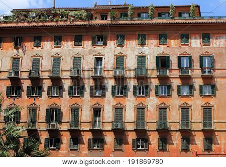 Facade of an ancient building in the historic center of Rome, Italy.