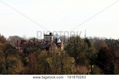 Landscape with a modern mansion in London, UK. View from Hampstead Heath
