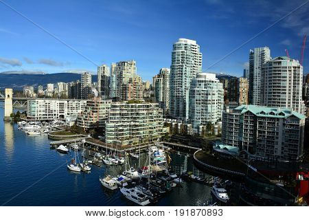 Vancouver BC,Canada,February 20th 2017.The skyline of Vancouver at False Creek makes for awesome urban landscape. High rises condo buildings and marinas makes for high end real estate in Vancouver.