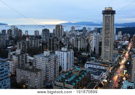 Vancouver BC,Canada,February 18th 2017.Skyline of Vancouver and famous Robson street with English Bay in the background.Condos and apartments dot the skyline.
