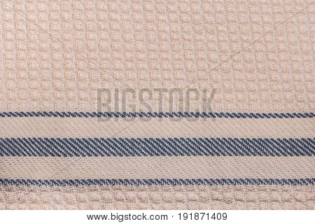 Blue and white striped towel fabric. Tablecloth texture. Cotton texture closeup background