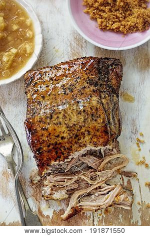 Slow cooked pork belly hog roast with brown sugar and apple sauce