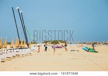 Corralejo, Fuerteventura, April 01, 2017: Unknown People On A Beach In Corralejo, Fuerteventura, Can