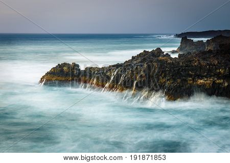 Long Exposure Shot Of Coast At Lanzarote, Los Hervideros, Spain