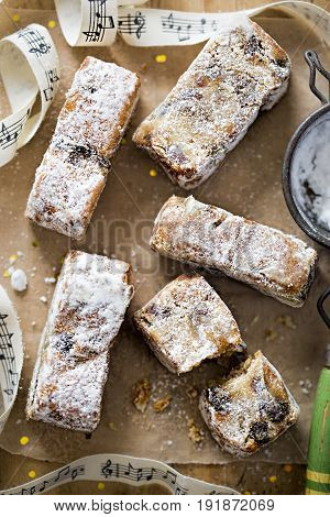 Christmas stollen slices with icing sugar and festive decoration