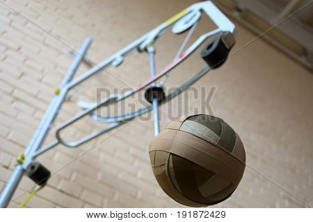 Simulator for training in volleyball attack hit in sport hall, shallow dof