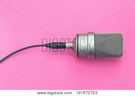 Mic professional diaphragm microphone. On isolated pink background