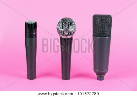 Various Professional Microphones On Pink Background