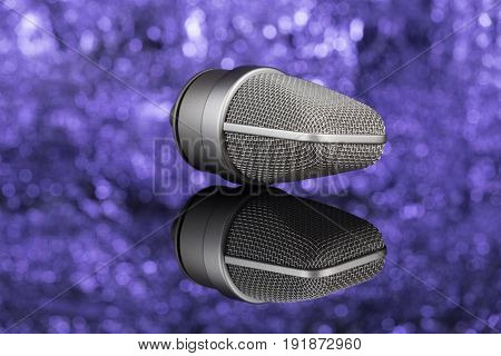 Profoseional Microphone In Unfocused Background. Mic