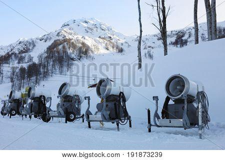 Five snowmakers on snow on mountain in ski resort, Krasnaya Polyana, Sochi, Russia