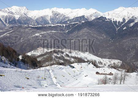 Ski resort in mountains at winter day in Krasnaya Polyana village, Sochi, Russia