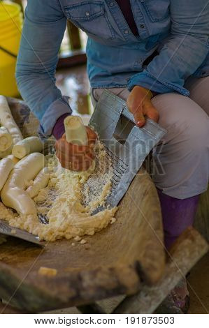 Grated yucca being prepared for bread in a Siona village in the Cuyabeno Wildlife Reserve, Ecuador.