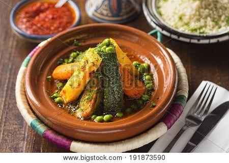 Vegetable tajine with rice and tomato sauce