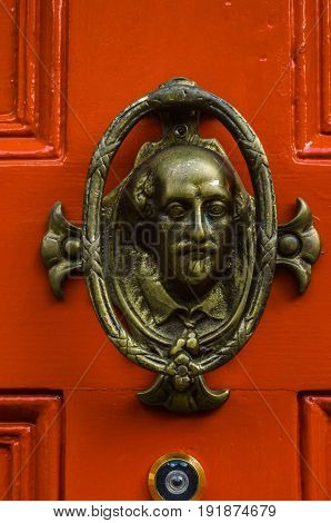 Door With Brass Knocker In The Shape Of A Human's Head, Beautiful Entrance To The House