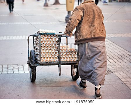 Man delivering eggs in the morning Africa Morocco Marrakech