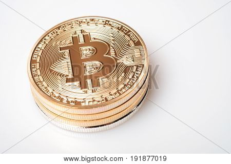 Stack golden bitcoin isolated on white background