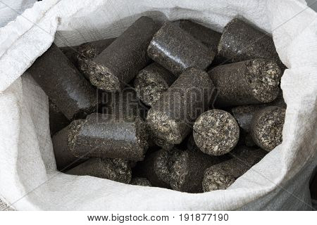 sunflower shell biomass briquettes in the white bag