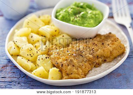 Battered haddock, cut potatoes with pea puree