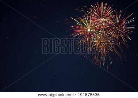 Golden Red Green Fireworks Over Night Sky